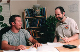 Photo of David with a student